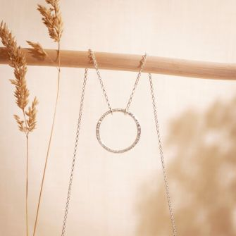 Recycled sterling silver circle necklace with a hand textured finish