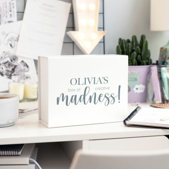deep white magnetic gift box with Olivia's box of creative madness! on the front in black