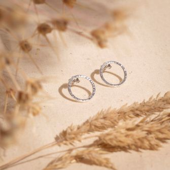 Recycled sterling silver circle studs with a hand textured finish