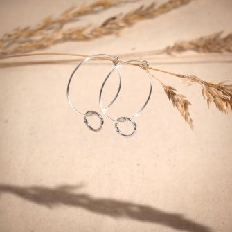 Recycled sterling silver hoop earrings with a hand textured circle charm