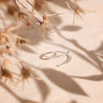 Recycled sterling silver spiral ring with a hand textured finish