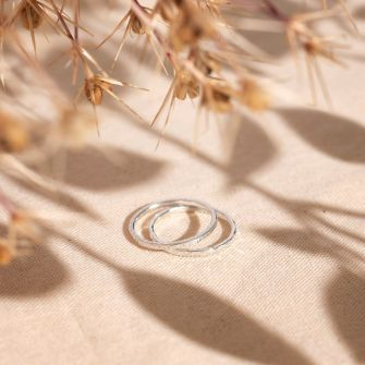 Recycled sterling silver stacking rings with a hand textured finish