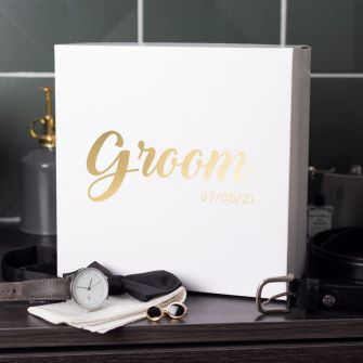 Face on view of large white magnetic close gift box. The word groom is central landscape on the lid and underneath is the date 07/05/21